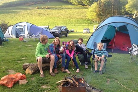 A family enjoying a scamp fire