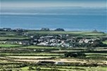 View of Trevaylor Caravan & Camping Park from the Moors, with the Isles of Scilly in the distance