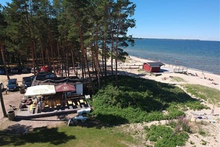 Valkla beach and beach bar, on the left side there is a camping site under the forrest