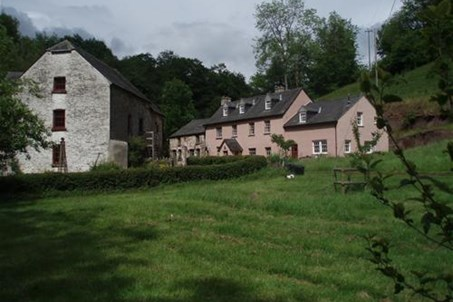 Priory Mill, Farm House and Holiday Cottage with camping meadow in the foreground.