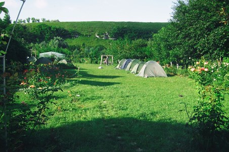 The campsite with tents.